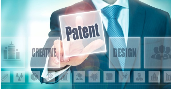 businessman-selecting-a-patent-concept-button-picture-id835232934